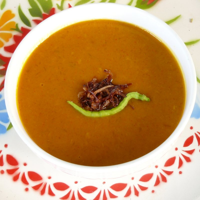 Pumpkin soup. Fresh chili and fried shallots on top